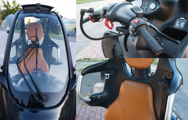 Mosós ablaktörlő és furcsa karok a parkolásrögzítéshez. A piros fül a biztonsági övek kioldását szolgálja